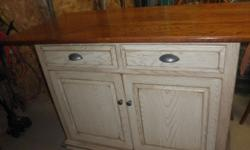 "Beautiful Amish made kitchen island. Top measures 64"" by 30"". Inside measures 42"" by 18"". Center adjustable shelf inside. Extremely well made and in new condition. Two stools avilable for $80 per stool. Call: 585-322-4378"
