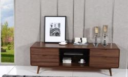 Quick and FREE Shipping within New York City. For more information call us or visit our page: https://www.furniturenyc.net/tv-stands.html Providing Midcentury style, this charming TV stand boasts of warm walnut finish and 4 drawers with glass shelf for
