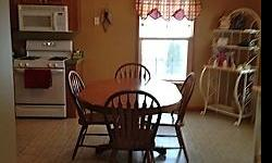 "Mission style, solid oak. 48"" round table with 4 - 12"" leaves. 6 chairs. Good condition."