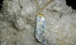 b. Exceptional and Beautiful Deep Sky Blue Kyanite Crystal Charm with Gold Crown. This is a Beautiful Kyanite Charm Hand Crafted by Paulsgems Creations. The Charm has Blue/White Metallic Sheen thru-out especially in the light. This Charm Shows Dazzling
