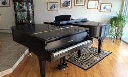 "This fabulous piano would assure a ""Grand"" holiday, but now that we also own a vintage Steinway Grand, we don't want to hog all the joy. Voiced, regulated, and tuned to A440, all in 2014, this American-made 5'8"" Baldwin R has wonderful tone and touch. Its"