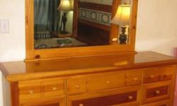 Very well made bedroom set by Vaughan-Bassett. Its about 15 years old, but in very good condition. Real wood. Plenty of storage too. Queen size bed. Does not include bed rails. We're selling it only because we'd like a change. Priced to sell. Long