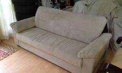 This Beige, microfiber suede couch is only 2 years old and has been virtually in storage, barely used by my family as it did not match our current room. Bought for 300, the price is negotiable. Professionally cleaned and ready for a new home! supremely