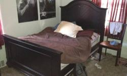 Black Full Size Bedroom set. Very good condition includes bed headboard footboard mattress, boxspring, Chest and night stand