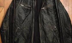 LIKE NEW WOMENS LEATHER JACKET. ONLY WORN A FEW TIMES SIZE MEDIUM BEAUTIFUL JACKET..... ALSO-WOMENS BLACK LEATHER HARLEY DAVIDSON BOOTS SIZE 7 BOOTS ARE GENTLY WORN