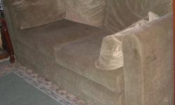 "Brown velvet love seat, in very good conditional, with pull out bed. Size: 72""l x 28""h x 33.5""d."