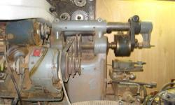 Smaller milling machine, probably weighing between 300 and 500 pounds. Fits on relatively small area. Variety of Horzontal cutters included. 3 phase motor has been mofified to become a multi-step pulley powered byn a standard 110 volt motor. Motor starter