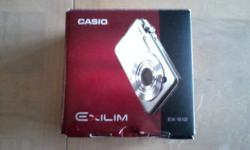 Casio Exilim EX-S12 digital camera / 12MP / 3X optical Zoom / 2.7 LCD / silver / in box with all attachments in wrapping / carry case. Used once. Thanks Charlie (cdbl317 aol)
