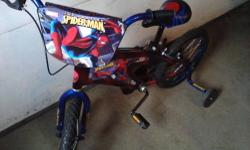 "MONGOOSE BOY'S 16"" BMX BIKE WITH PEGS, HEAVY FRAME, TRAINING WHEELS, BOTH PEDAL & HANDLE BRAKES. PRACTICALLY NEW - NUBS STILL ON TIRES. EXCELLENT CONDITION. BIKE LOOKS BETTER THAN PICTURED, ""SHINY"" - LOOKS LIKE NEW. SELLING FOR OVER $114 AT WALMART -"