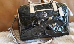 New - never used Black patent leather signature bag Beige leather trim and straps Size: 12 x 8 1/2 x 4 1/2 Includes Shipping