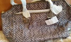 New - Never Used -Original Tag Snakeprint Canvas Tote Leather Straps and Trim Size: 13 x 8 x 18 Original aprice $398.00 Includes Shipping