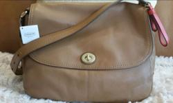 New - never used - original tag British Tan Leather Size: 11 1/2 x 9 1/2 x 3 Original Price $358 Includes Shipping
