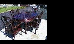 LOVELY CHERRY WOOD DINING ROOM TABLE SERVICE FOR 2 OR 6 HAS REMOVALBLE LEAFS, BALL AND CLAW LEGS , NICELY CARVED WITH DRAGONS, GOD'S ,ETC EXCELLENT CONDITION , VERY WELL BUILT. FREE DELIVERY AND SET UP LOCATED IN AMITY , NY $ 1500 B/O GET IT IN TIME FOR