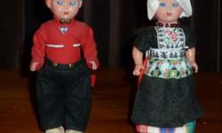 "Dutch boy and girl doll--about 8 1/2"" tall.The original container in which they came says ""Haly Elcee Made in Holland."" Excellent condition from smoke-free home. Doll stands are included. Mirrored display cases are available for $7.00 each."