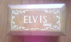 Elvis presly wooden music box plays 8 different songs it is in great condition it would make a wonderful present for a Elvis fan 500.00 or best offer