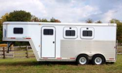 This Exiss Event (XT 200 ) is in GREAT shape. It has only been used for my horses. Has very little millage. It has a polished aluminum nose,bulldog hitch and break away brake system. The Tack room : has sleeping area (never been used). Blanket bracket,