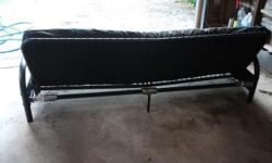 Black Futon, folds down. Black frame, no rust. Mattress has some fading. Asking 60.00.