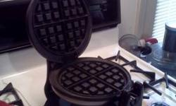 "Got last year for Christmas and has only been used twice since. Makes 1"" thick, 6 3/4"" round waffles, 950M, brushed stainless steel design, rotating system for even baking and browning, non-stick coating for easy cooking and cleaning, compact size for"