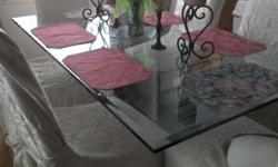Solid glass dining table, seats six. Excellent condition.