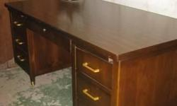 Rare Globe Wernicke steel tanker desk. This desk is in very good condition. During World War II, Globe Wernicke started making office furniture for the military. Afterwards, these desks found there way into businesses around the world. Today, there super