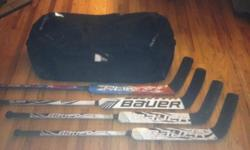 "this set includes... -1 senior Reebok 18K goalie hockey bag -2 intermediate Bauer p31 (24.5"") goalie sticks with 3 years of use -1 senior Bauer Supreme 1.7 p39 (26.5"") goalie stick with less than one season of use -1 senior RBK C. Huet (25"") goalie stick"