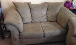 Living room set in good-to-great condition! Set includes a couch, loveseat, large chair and ottoman. Fabric is in good condition on all pieces. Couch has lost some support in the middle, loveseat and chair have good support still. Comes from a pet-free