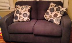 Grey sofa and loveseat, with large pillows to go with it. Good condition. Please call me or text.