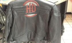 Women's Harley leather jacket. Like new. Size 40 (med) comes with removable faux fur collar.