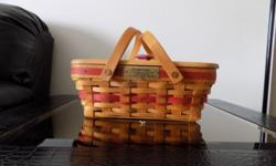 Green or Red Holiday Cheer Longaberger Baskets good condition each has hardwood maple top and plastic protector. The one includes a liner. Buyer pays all shipping costs in addition to the cost of the baskets. Red basket $60.00 each, Green basket with