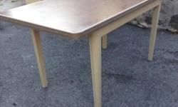Are you looking for a table that's virtually indestructible? If so, you can't go wrong with a metal tanker table from the industrial age. Good condition. Very sturdy. Use as-is or consider spray painting to match decor. Professionally refinished you'd pay