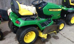 John deer trackter with mower deck tirer chains mower deck