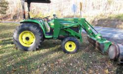 John Deere 460 Tractor With front bucket Well maintained at schedueled maintenance intervals, and in excellent condition. 2,300 hours of use