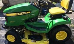 "2009 John Deere X320 Lawnmower with 48 inch ""Edge Extra Mowing System"" mowing deck. Immaculate condition. Service up to date. New belt and blades on mower deck. 44 inch Snowblower attachment with weights and tire chains. Runs like new... downsizing due to"