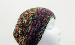 Lots of color is what this hand knittedbeanie hat has. Red purple,orange,bright green,blue just to name a few. Thick and warm beanie. Knitted with two strands of yarn. Fits men,women and teens. Very stretchy, will fit any head, stretches out to 31 inches
