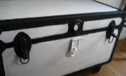 This old trunk is vintage antique & collectible for those that like the larger size trunks that can be made also into coffee table or even benches. Nicely painted in black and white, it has 4 large wheels, great to move around, especially in small places.