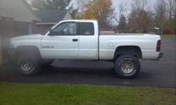 "99 dodge ram 1500 ext cab 5.2 v8 with 170k mi. White in color new head liner 5"" BDS suspension lift 80% left 35-12.50x15 BFG all terrain tires After market air filter flowmaster duel exhaust Runs great holds over 40psi oil pressure at idle. One rust spot"