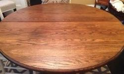 "48"" oak split base table with 4 - 12"" leaves, opens to 98"". 6 chairs, good condition. Early 1900's."