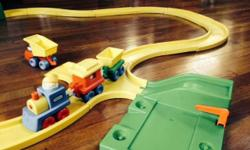 Selling my sons' Little Tikes train set, made of sturdy plastic. It's perfectly great, almost brand new. I just washed it thoroughly with hot sudsy water. It includes a 3-piece train, people, a dump truck, track, station and tunnel. The track has curved