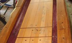 "For Sale is a custom built, log edge shuffle board table. It has a 10 ft. playing field. The total length of the table is 140.5"" long, 30"" wide and 33"" tall. This table is from a company out of Palatine Bridge NY. It was previously used in a game room for"