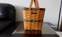 Longaberger Charter Membership basket includes liner and protector size is 9-3/4 inches. Good condition buyer pays all shipping costs in addition to the cost of the basket. Basket cost is $54.00.