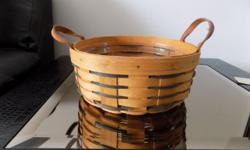 Longaberger Heartland Basket, protector included 10'' in size. Buyer pays all shipping costs in addition to the cost of the basket.