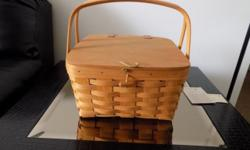 Longaberger Picnic Basket small, includes protector and lid, size is 12''. Buyer pays all shipping costs in addition to the cost of the basket.