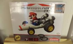 THIS IS A BATTERY OPERATED SLOT CAR SET.THIS IS A COMPLETE SET ALL IN EXCELLENT LIKE NEW SET USED ONCE.THIS BOX HAS SOME WEAR.THIS IS FOR AGES 4 & UP.THIS IS A MUST FOR ANY MARIO KART FAN.