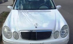 PRICE NEGOTIABLE. YOU ARE LOOKING AT A GORGEOUS 2003 MERCEDES E 500 SPORT EDITION . THE SPORT EDITION COMES w/ PANORAMIC ROOF (Front & Back), WHITE DASH, LEATHER INTERIOR WHICH HUGS YOU ON EVERY TURN, GORGEOUS 17 INCH SPORT WHEELS, XENON HEADLIGHTS, FOG