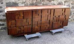 "Here?s a cubist inspired nine drawer dresser made by Lane Furniture Co. in the 1960?s. Made of walnut. This beautifully scaled piece needs some TLC, but structurally sound and functions flawlessly. Worth thousands if refinished. Dimensions: 30"" H x 78"" W"