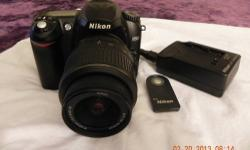 "Nikon D50 interchangeable-lens digital SLR camera. Great Entry level camera for a Photographer or Inthusiust. It has a crack on the screen but works just as great as it did when it was new. It also has a ""remote"" to snap pics on command, so you can"