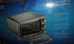 "Oster Toaster Oven Extra-large interior holds 13x9"" pan Whole Chicken,roast ham or frozen pizza Original $150.00 now $ 75.00 new in box"