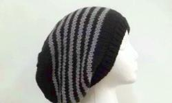 The color is black with light gray stripes. Hand knitted. Suitable for men or women. This oversized beanie hat, slouchy beanie is great for cold winter days. This slouch hat is made acrylic yarns. The slouch hat stretches out to 31 inches around The