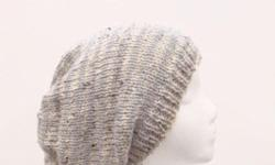 This oversized beanie slouch hat is knitted in tan and gray small stripes (1/2 inch). An interesting texture in this slouch hat that the yarn has tiny flecks of dark brown and light brown worked into it. This slouch hat is a medium thickness, very