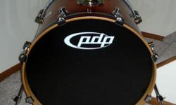 PDP Bass/Kick Drum (manufactured by DW). Excellent/mint condition. 7-ply, all maple shell with lacquered finish in Tobacco Burst color. 8 lugs per side. 18 inches deep. 22 inches diameter. Comes with muffling pillow - has three strips to mount inside if